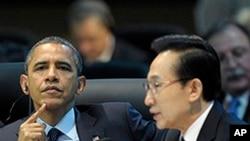 奥巴马总统3月27日在首尔的核安全峰会上倾听韩国总统李明博讲话