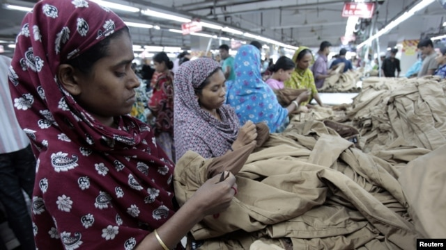 Women work at a garment factory in Savar, Bangladesh, July 27, 2012.
