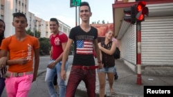 Teenagers walk on the street in Havana, December 21, 2014.