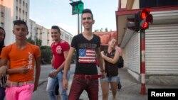 Teenagers walk on the street in Havana.