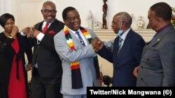 President Emmerson Mnangagwa welcoming to Zanu PF former MDC-T vice president Obert Gutu and MDC legislator James Makore.