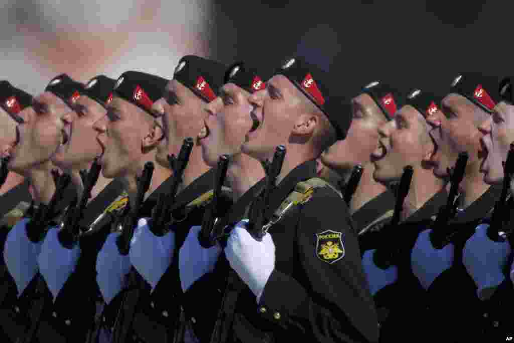 Russian Marines salute as they march along Red Square, Moscow, during a Victory Day parade.