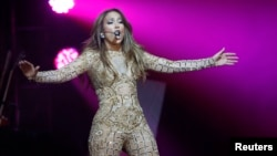 Jennifer Lopez performs at the Muhammad Ali Celebrity Fight Night Awards XIX in Phoenix, Arizona March 23, 2013. The charity event is held in honor of Muhammad Ali's fight to find a cure for Parkinson's disease, according to the organisers. Picture taken