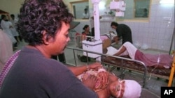 A Phnom Penh resident is treated for wounds at Calmette Hospital he received during a mortar attack in the capital in the late afternoon on Saturday July 5,1997. Fighting broke out between troops loyal to the rival prime ministers and shellfire hit downto