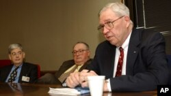 FILE - Dr. Donald Henderson speaks at the University of Arkansas for Medical Sciences about the risks of bioterrorism, Little Rock, Arkansas, Dec. 11, 2003.