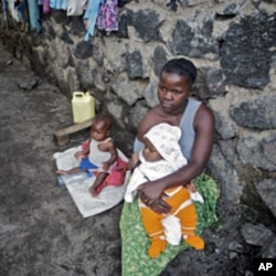 A woman looks after her two babies after being abandoned by her husband for being raped, in Goma (File)