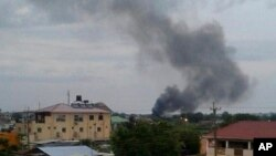 Black smoke is seen rising above South Sudan's capital, Juba, on July 10, 2016. Days of fighting have included attacks on United Nations facilities. The UN says the attacks could be considered war crimes.