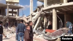 A damaged area is pictured after a car bomb in Qatana, near Damascus December 13, 2012 in this handout photograph released by Syria's national news agency SANA.
