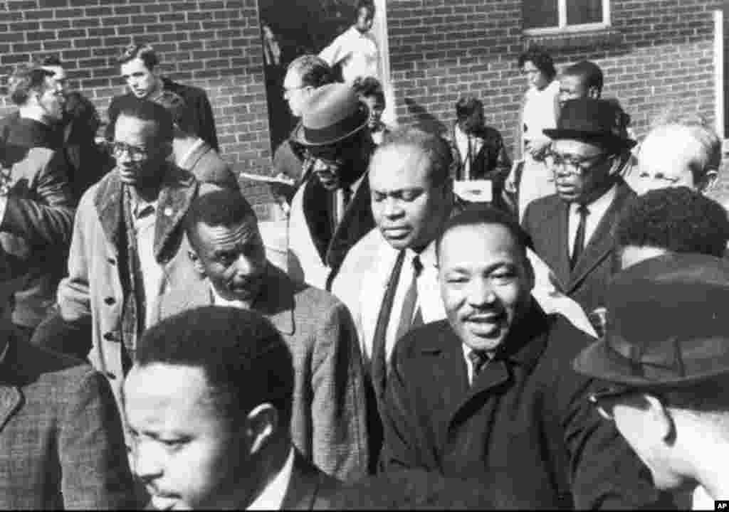 Civil rights leader James Farmer is shown in this undated family photo standing behind the Rev. Martin Luther King, Jr. (AP Photo/HO)