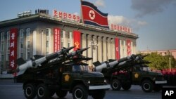 FILE - North Korean soldiers parade through Kim Il Sung Square with their missiles and rockets during a mass military parade.