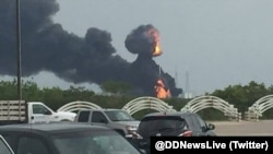 佛罗里达州卡纳维尔角太空探索科技公司(SpaceX)发射场星期四发生爆炸,浓烟升起在发射场上空。(2016年9月1日)
