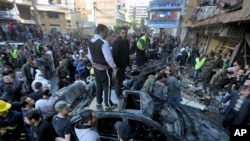 Lebanese citizens gather at the site of a car bombing in a southern suburb of Beirut, Lebanon, Jan. 21, 2014 (AP Photo/Bilal Hussein)