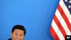 Chinese Vice President Xi Jinping speaks with U.S. Vice President Joe Biden (not pictured) at a China-U.S. Business Dialogue in Beijing, China, August 19, 2011.