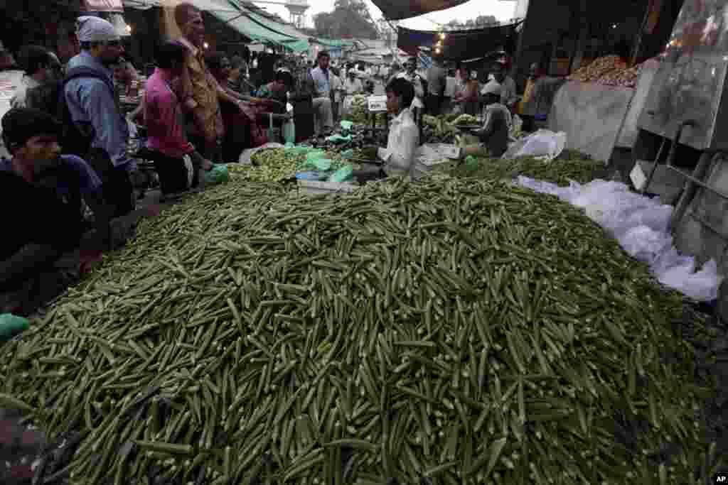 Indians shop at a vegetable market in Ahmadabad.