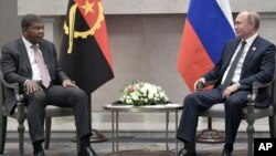 FILE - Angola's President Joao Lourenco, left, speaks to Russia's President Vladimir Putin at the BRICS summit in Johannesburg, South Africa, July 26, 2018. With its summit meeting in Sochi, Russia hopes to build economic, security ties.