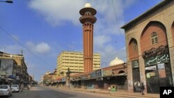 Karachi's busiest street is deserted after a strike called by Pakistani political party, August 23, 2011