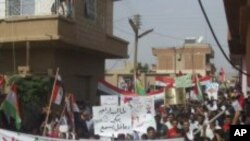 Demonstrators protesting against Syria's President Bashar al-Assad march through the streets after Friday's Prayers in Amude, September 30, 2011.