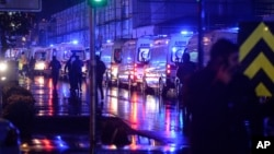 FILE - Ambulances wait near the scene of an attack in Istanbul, early Jan. 1, 2017.