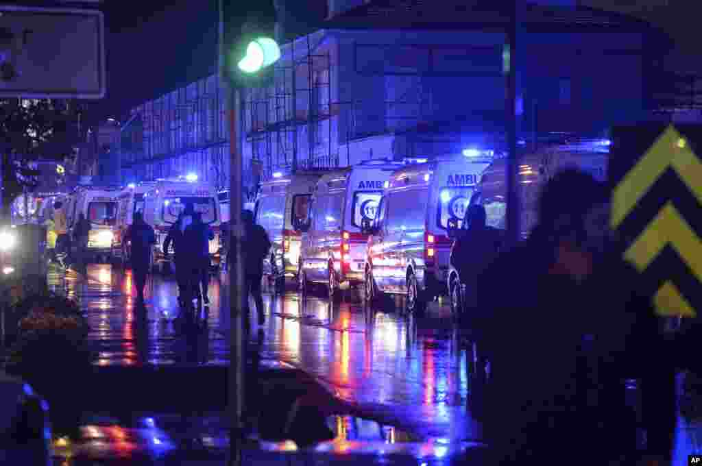 Ambulances wait near the scene of an attack in Istanbul, early Jan. 1, 2017.