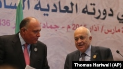 Arab League Secretary-General Nabil Elaraby, right, and Egyptian Foreign Minister Sameh Shukri leave a press conference at the conclusion of an Arab summit meeting in Sharm el-Sheikh, South Sinai, Egypt, Sunday, March 29, 2015. (AP Photo/Thomas Hartwell)