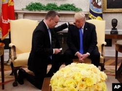 FILE - President Donald Trump prays with American Pastor Andrew Brunson in the Oval Office of the White House, Oct. 13, 2018, in Washington. Brunson returned to the U.S. after he    was freed Friday, having been detained for nearly two years in Turkey.