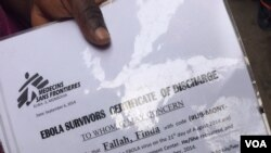 Without an official certificate, it is hard for Ebola survivors to become eligible for support. Some people who are not survivors present fake documents. This is survivor Finda Fallah's document. (Benno Muchler/VOA)