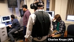 Students at Boston College in Boston, Massachusetts use one of their professors to test special technology for a video game they are developing.