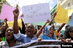 FILE - University students join a demonstration condemning the gunmen attack at the Garissa University campus, in the Kenyan coastal port city of Mombasa, April 8, 2015.
