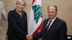 In this photo released by Lebanon's official government photographer Dalati Nohra, French far-right leader and presidential candidate Marine Le Pen, left, shakes hands with Lebanese President Michel Aoun, at the presidential palace, in Baabda, east Beirut, Lebanon, Feb. 20, 2017.