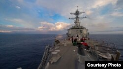 The Arleigh Burke-class guided-missile destroyer USS Dewey (DDG 105) transits the South China Sea. (U.S. Navy Photo By Mass Communication Specialist 3rd Class Kryzentia Weiermann/released 5/6/2017)
