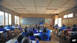 Pupils at the Olympic primary school sit in class on without a teacher on the third day of a teachers' strike organized by the Kenya National Union of Teachers, in Nairobi, Kenya, September 7, 2011.