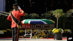 The casket with the remains of Winnie Madikizela-Mandela receives a salute at her funeral service at the Orlando Stadium in Soweto, South Africa, April 14, 2018. Madikizela-Mandela died on April 2 at the age of 81.