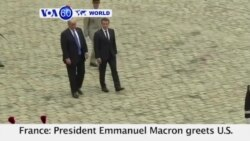 VOA60 World PM -French President Emmanuel Macron greets U.S. President Donald Trump at the Elysee palace