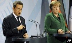Nicolas Sarkozy et Angela Merkel à Berlin, le 9 octobre 2011