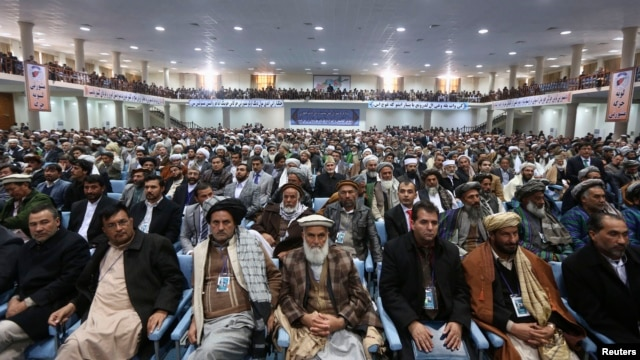 Members of the Afghan Loya Jirga attend a gathering in Kabul, Nov. 21, 2013.