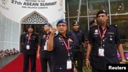 Police officers check security arrangements for the 27th Association of Southeast Asian Nations (ASEAN) summit in Kuala Lumpur, Malaysia, Nov. 20, 2015.