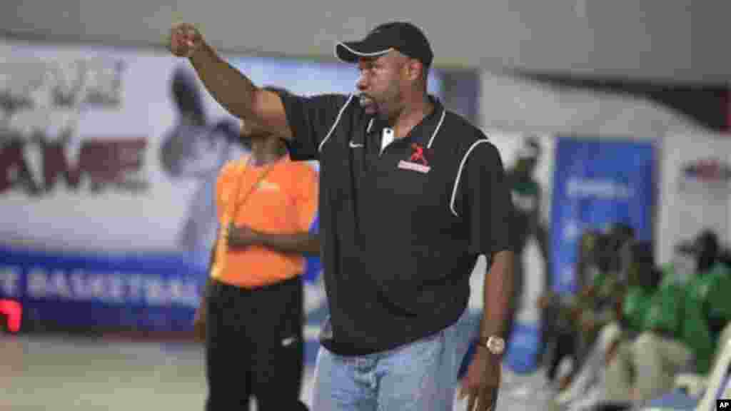 Joe Touomou, head coach Mark Mentors and a consultant to the Nigeria Basketball Federation, give instructions during a basketball match between Mark Mentors against Kano Pillars in Lagos, Nigeria.