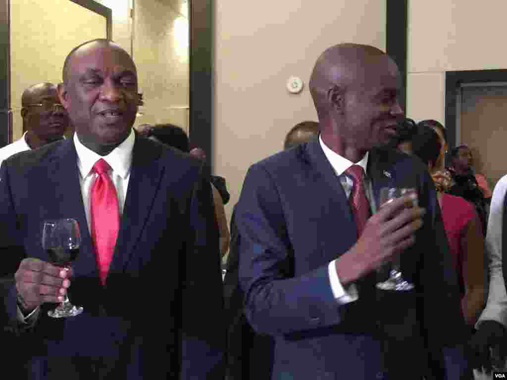 Haiti's President-elect Jovenel Moise participates in a toast with Senate leader Youri Latortue on the eve of the inauguration in Port-au-Prince, Haiti. (Photo: VOA Creole Service)
