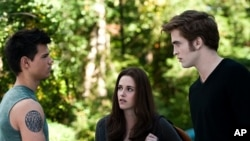 "Taylor Lautner, left, Kristen Stewart and Robert Pattinson star in ""The Twilight Saga: Eclipse"""