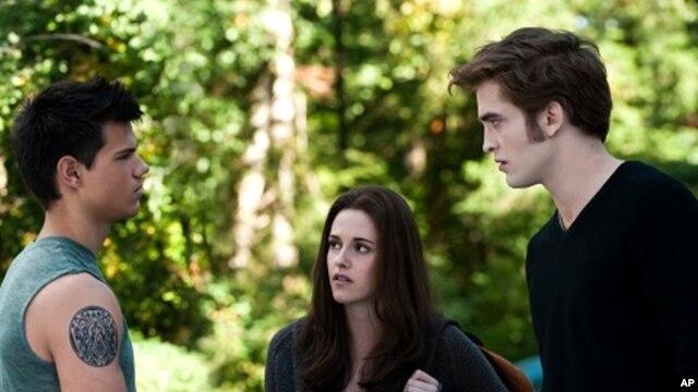 "Taylor Lautner, left, Kristen Stewart and Robert Pattinson star in ""The Twilight Saga: Eclipse"""