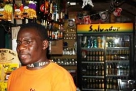 "Emton Kalimanjira behind the bar at Kaapsche Hoop, South Africa...He enjoys meeting lots of ""strange, but wonderful"" people from all over the world here"