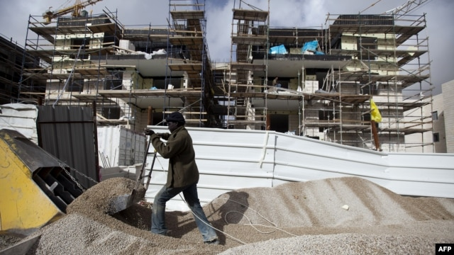 A labourer works at the construction site of a new housing project at the Jewish settlement of Gilo in east Jerusalem, December 20, 2012