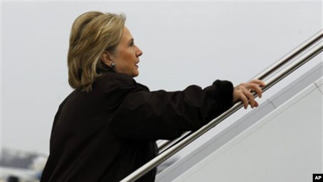 Secretary of State Hillary Clinton boards her plane for a trip to Haiti at Andrews Air Force Base outside of Washington, DC, January 30, 2011