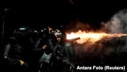 Police fire tear gas at protesters in Tanah Abang, Jakarta, Indonesia, early May 22, 2019 in this photo taken by Antara Foto.