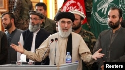 FILE - Former Afghan warlord Gulbuddin Hekmatyar speaks to supporters in Jalalabad province, Afghanistan, April 30, 2017. Hekmatyar cautions that a fall of President Ashraf Ghani's administration would result in Kabul being overrun by the Taliban.
