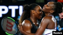 Serena Williams embraces her sister after winning her women's singles final match against Venus Williams.