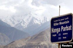 FILE - A view of a snow-packed Nanga Parbat, the world's ninth highest peak, in northern Pakistan, July 14, 2004.