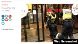 Cảnh sát Thụy Điển mang người đàn ông Trung Quốc ra khỏi khách sạn ở Stockholm. Photo The Star Online.