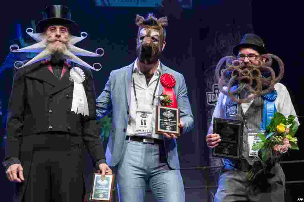 (L-R) Third, second and first place winners of the full beard freestyle: Aarne Bielefeldt, Isaiah Webb, and Jason Kiley at the 2017 Remington Beard Boss World Beard & Moustache Championships held at the Long Center for the Performing Arts in Austin, Texas, Sept. 3, 2017.