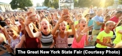 Fans cheering for a musical performer the New York State Fair.
